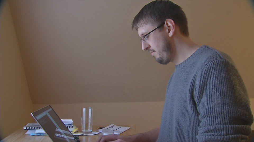 Software developer Corey O'Brien works at home in Silver Oaks