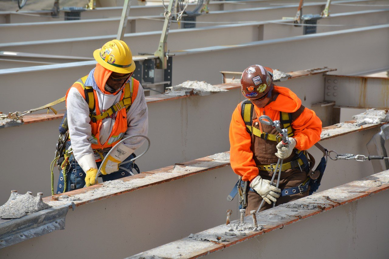 Charles Ewing and Juliana Johnson, ironworkers, at work on the deck of the Kennedy.