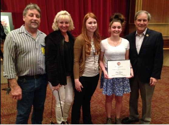 Raquel Masterson with her parents, teacher and Rep. John Yarmuth on Tuesday, March 8, 2016 (Photo by Toni Konz, WDRB News)