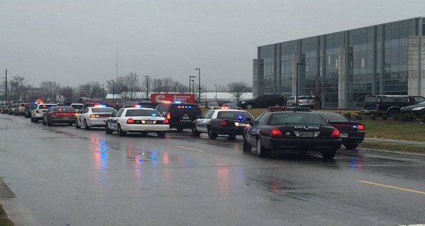 Heavy police presence outside the Cummins Engine Company in Seymour, Indiana after a double shooting on March 10, 2016.