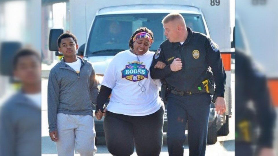 This photo of Asia Ford crossing the finish line with LMPD Lt. Aubrey Gregory went viral in 2015.