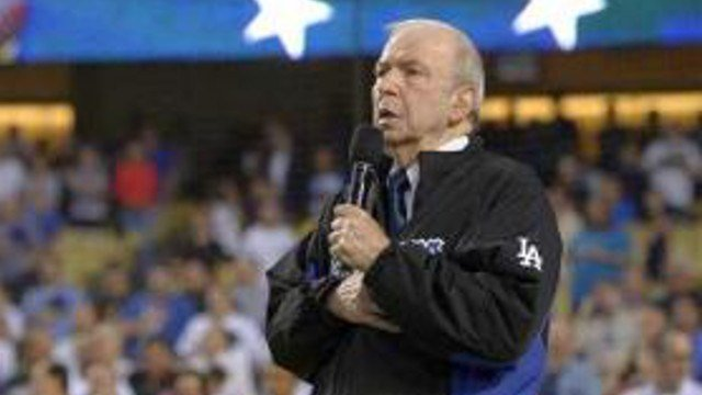 THE ASSOCIATED PRESS FILE - In this Sept. 18, 2015, file photo, Frank Sinatra, Jr. sings the national anthem prior to a baseball game between the Los Angeles Dodgers and the Pittsburgh Pirates in Los Angeles.