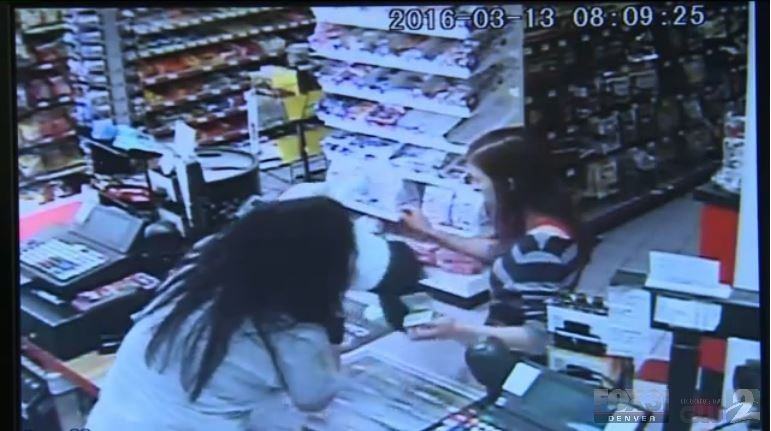In surveillance video from the store, you can see the clerk reach across the counter to take the baby from the mother who appears unresponsive.