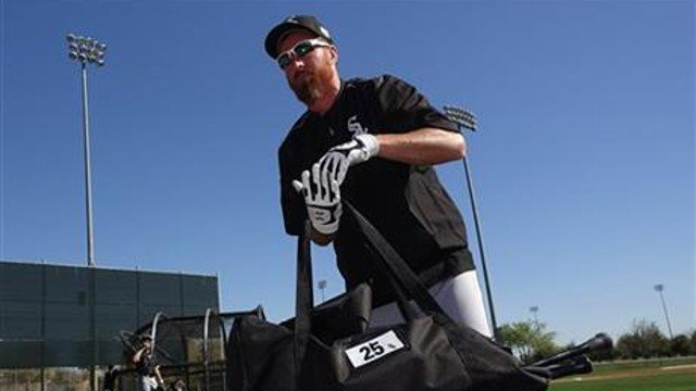 In this Feb. 26, 2016, file photo, Chicago White Sox's Adam LaRoche picks up his gear a fter taking live batting practice during a spring training baseball workout in Glendale, Ariz. (AP Photo/Ross D. Franklin, File)