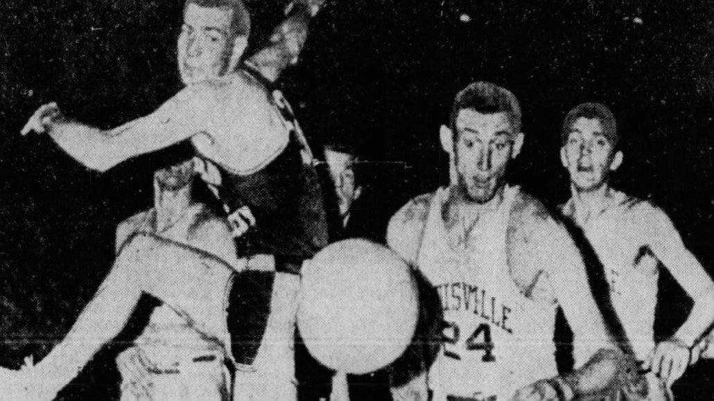Don Goldstein goes after a loose ball against Eastern Kentucky in Louisville's first NCAA Tournament win in 1959. (Associated Press photo via Courier-Journal archive).