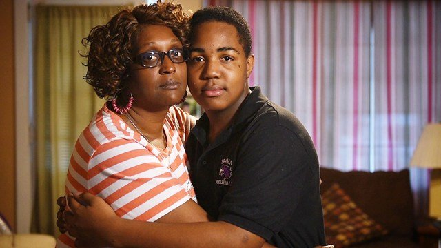 "Keith Pennington and mom Kim Y. Johnson in their Pittsburgh home Keith, whose father died in 2014, discussed his grief in a teen group at Highmark Caring Place and is part of the Post-Gazette documentary, ""Journeys Out of Grief."""