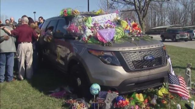 Dozens of police officers surrounded Deputy Carl Koontz's police car during Monday morning's ceremony outside the Howard County Criminal Justice Center in Kokomo, Indiana.