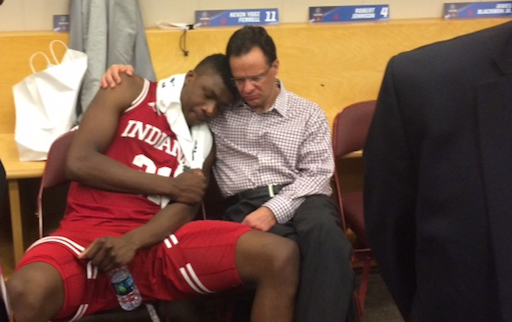 Indiana coach Tom Crean consoles freshman Thomas Bryant after IU was beaten by North Carolina in the NCAA Tournament.
