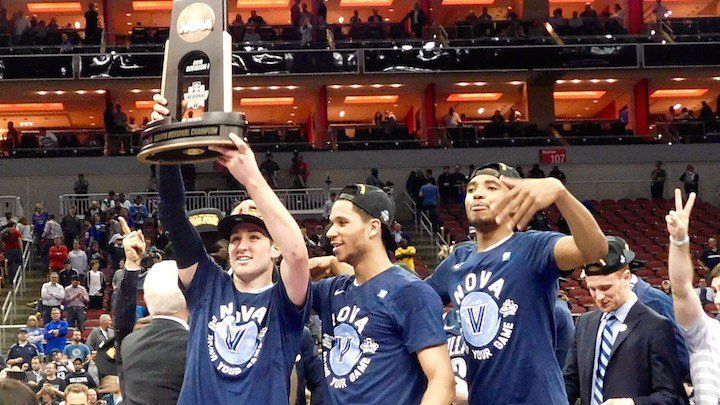 Villanova players celebrate after knocking off Kansas to reach the Final Four. (WDRB photo by Eric Crawford)