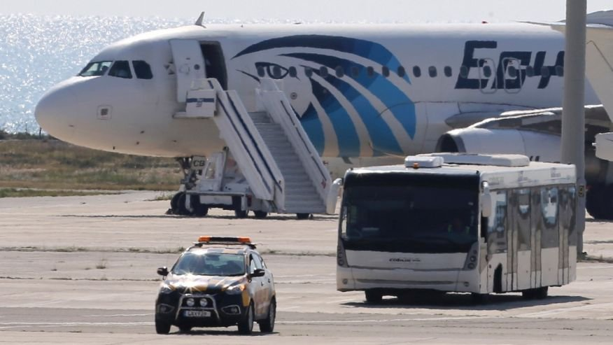 A bus carries some passengers away from a hijacked EgyptAir aircraft at Larnaca airport in southern Cyprus. (AP Photo/Petros Karadjias)