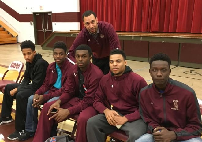 Doss High basketball coach Tony Williams with a few of his players (Photo by Toni Konz, WDRB News)