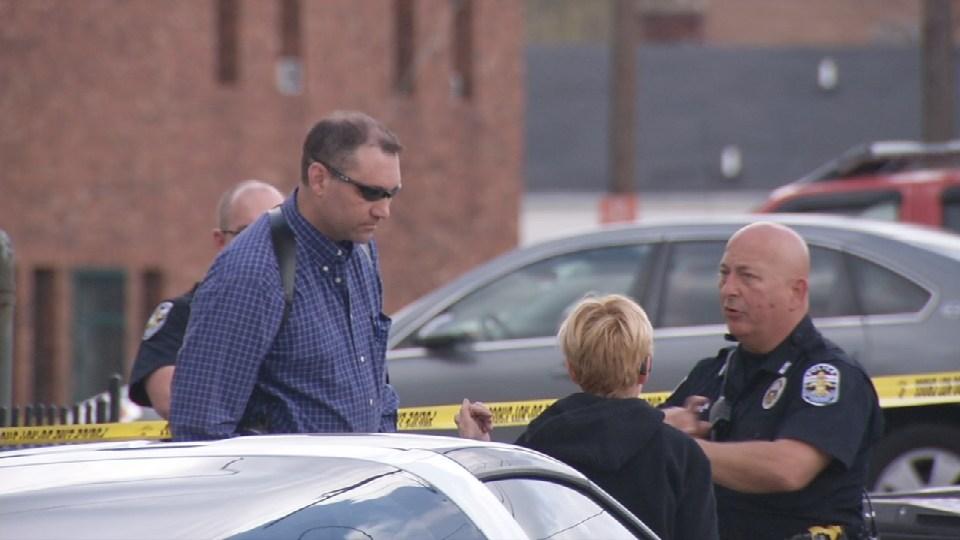 Crime scene following fatal shooting on East Oak Street in Louisville