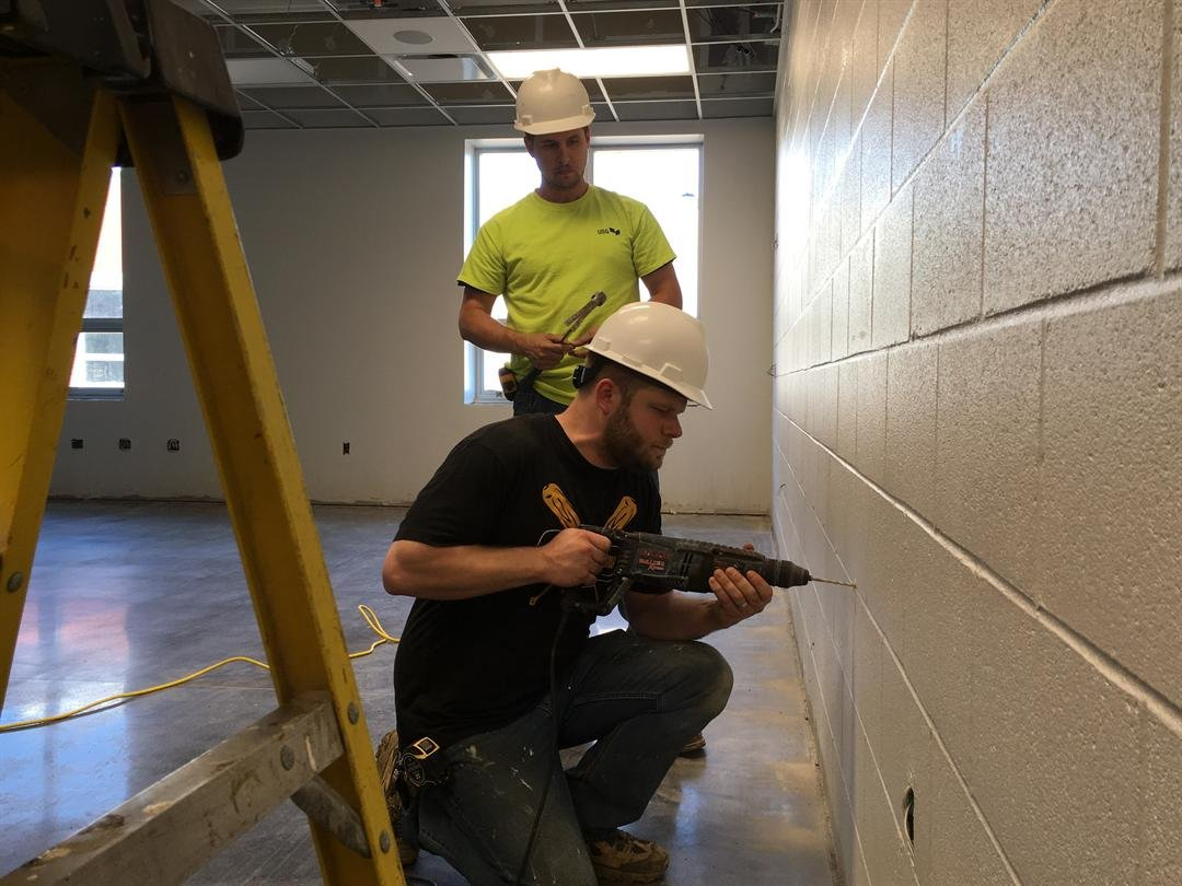 Construction workers work inside one of the school's classrooms (Photo by Toni Konz, WDRB News)