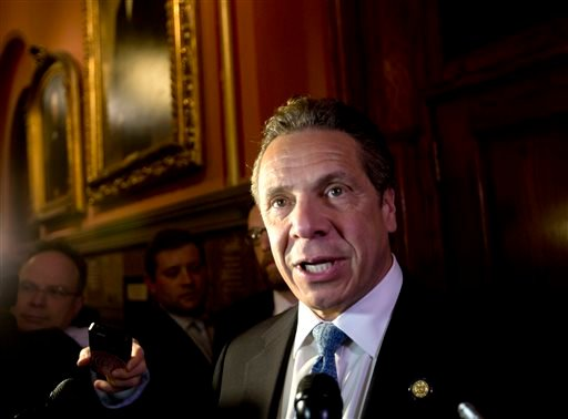 (AP Photo/Mike Groll, File). FILE - In this Wednesday, March 30, 2016 file photo, New York Gov. Andrew Cuomo talks to media members outside his office at the state Capitol in Albany, N.Y.