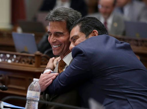 (AP Photo/Rich Pedroncelli). State Sen. Mark Leno, D-San Francisco, left, one of the authors of a bill to raise California's minimum wage, is hugged by Sen. Ben Hueso, D-San Diego, as the Senate voted on the bill, Thursday, March 31, 2016.