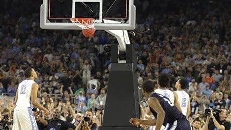 Kris Jenkins crouches as his game-winner goes down (AP photo)