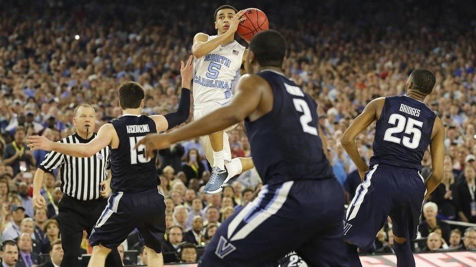 North Carolina's Marcus Paige makes an off-balance three with 4.7 seconds left to tie Monday night's NCAA championship game against Villanova. (AP photo)