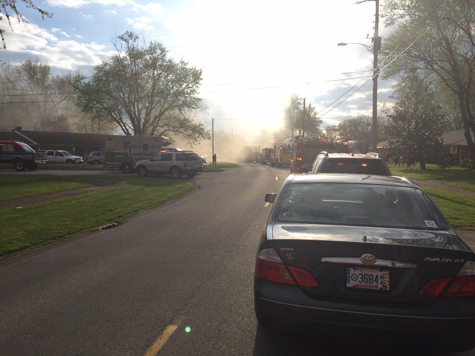 Scene of house fire in 2000-block of Kendall Lane in Shively Thursday. Josh Breslow/WDRB News