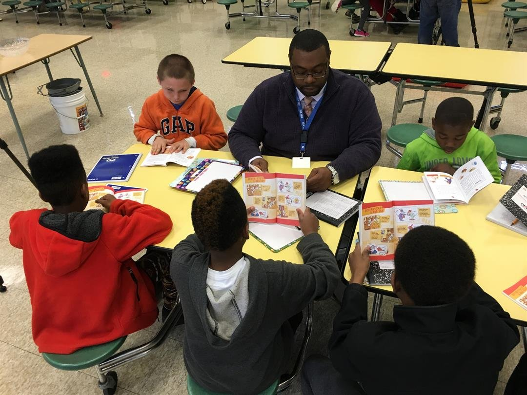 Dalton Holt works with students on literacy skills during a Spring Break camp at Byck Elementary School April 6, 2016 (Photo by Toni Konz, WDRB News)