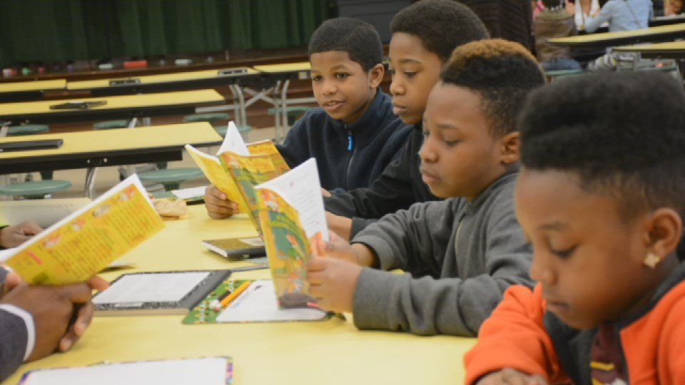 Students read during a Spring Break literacy camp at Byck Elementary School on April 6, 2016. (Photo by Beth Peak, WDRB News)