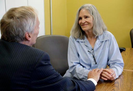 (AP Photo/Nick Ut). Former Charles Manson follower Leslie Van Houten confers with her attorney Rich Pfeiffer during a break from her hearing before the California Board of Parole Hearings.