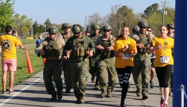 Brenda Tiffany, the mother of fallen Kentucky State Police Trooper Cameron Ponder, approaches the finish line in Saturday's memorial run (Photo by Toni Konz, WDRB News)