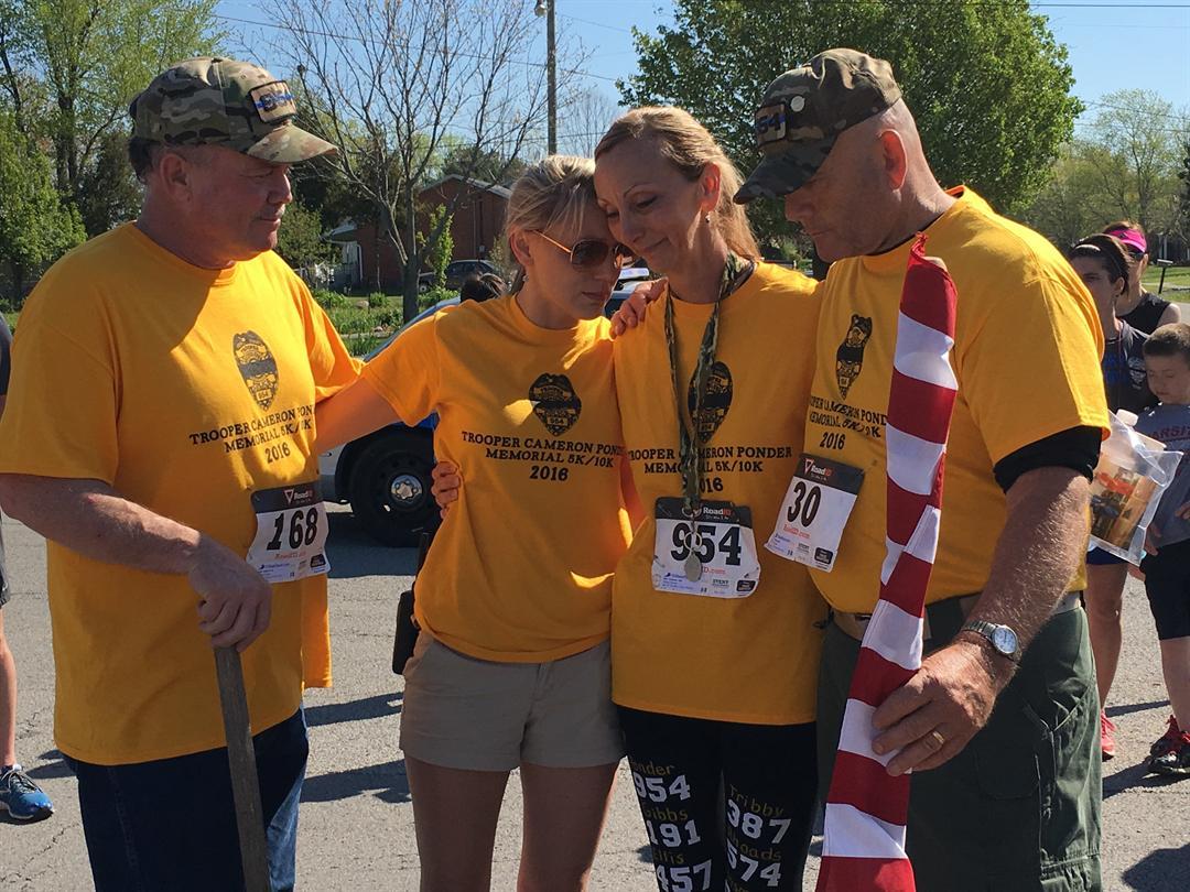 Joe Ponder, Aimee Hunt, Brenda Tiffany and Allan Tiffany at the finish line Saturday (Toni Konz, WDRB)