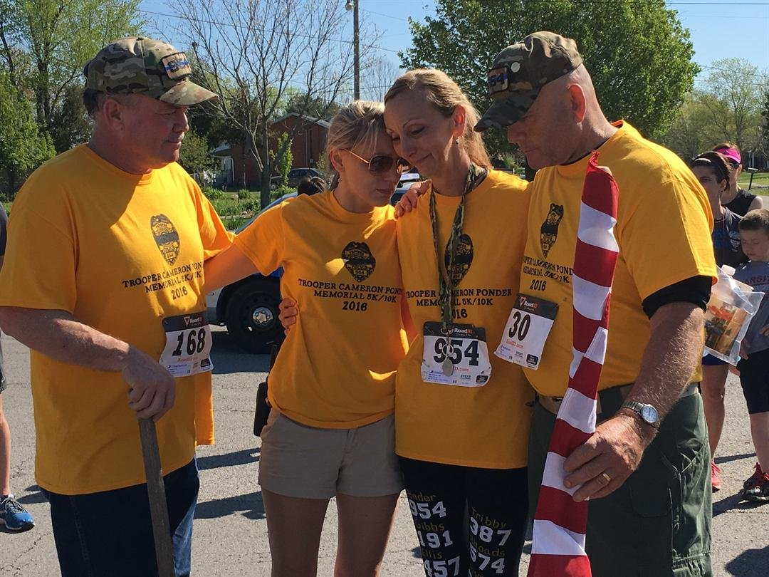 Joe Ponder, Aimee Hunt, Brenda Tiffany and Allan Tiffany at the finish line Saturday (Toni Konz, WDRB)