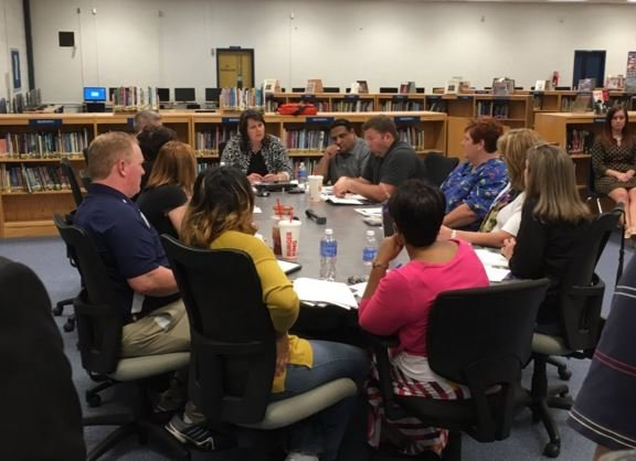 Members of the Moore Traditional School site-based council meets on Monday (Photo by Toni Konz, WDRB News)