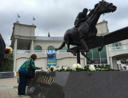 Fans gathered at the Barbaro statue outside Churchill Downs on Tuesday. Barbaro won the Kentucky Derby in 2006. (Photo Toni Konz, WDRB News)
