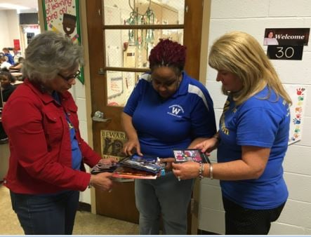 Jan Brazely, Kelly Boyd and Cheryl Barney talk about their friend, Jenny Pruett, in front of Pruett's fourth grade classroom on Wednesday (Photo by Toni Konz, WDRB News)