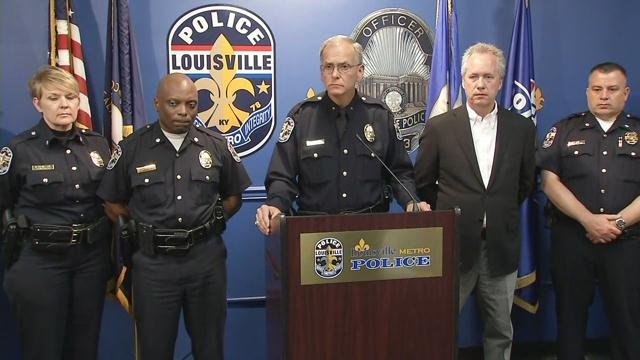 Louisville police chief Steve Conrad, center, and Mayor Greg Fischer, second from right, answer questions about double shooting near Pegasus Parade route in downtown Louisville Thursday.