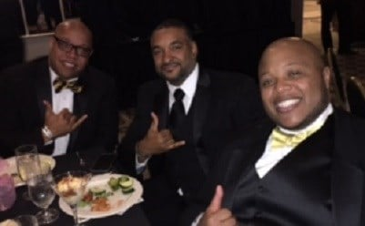 Members of the fraternity Alpha Phi Alpha proudly display their fraternity sign while enjoying the 100 Black Men of Louisville Gala.
