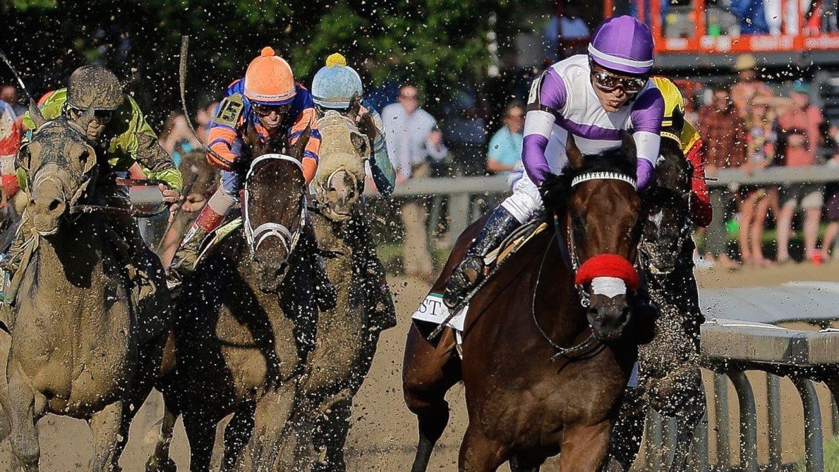 Jockey Mario Gutierrez takes Nyquist to the lead in the stretch of Kentucky Derby 142. (AP photo)