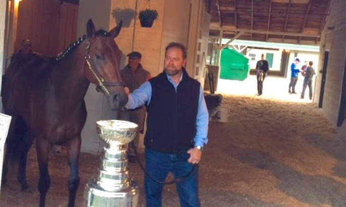 Trainer Doug O'Neill and Nyquist posed with the Stanley Cup.