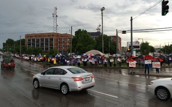 HUndreds of people rallied outside the JCPS board meeting on May 10, 2016.