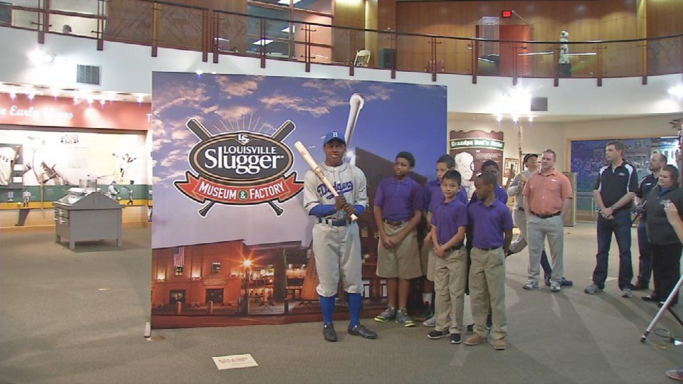 Students from the West End School were on hand at the Louisville Slugger Museum and Factory to unveil a statue honoring Jackie Robinson.