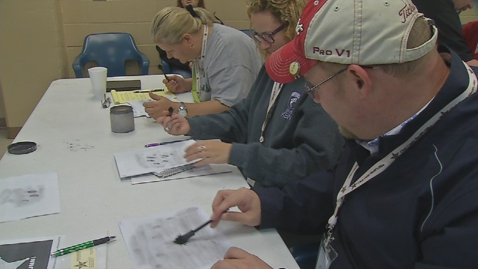 Clark County residents participate in Citizen's Police Academy and learn how officers find fingerprints.