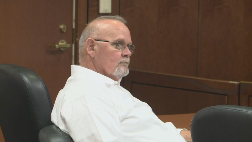 Donald Hayes listens as testimony continues in his murder trial.