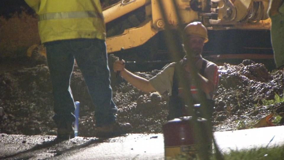 Crews work to repair water main break in Church Alley in Georgetown, ind., Thursday night.