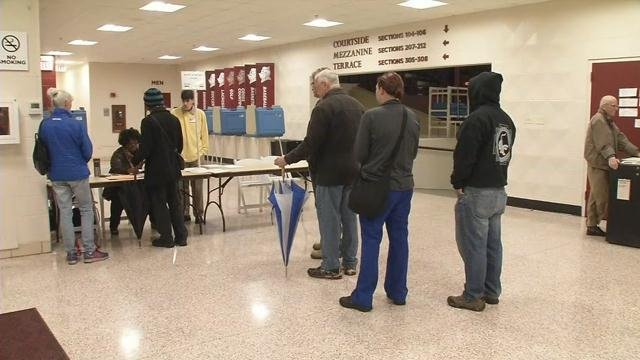 Kentucky residents wait to cast their vote in the state's primary.