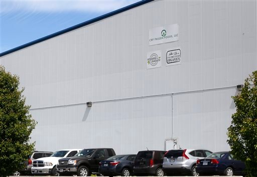 (Sarah Gordon/The Tri-City Herald via AP). This May 11, 2016, photo, shows the outside of CRF Frozen Foods, LLC, in Pasco, Wash. The company shut down its processing operations over a listeria breakout that has sickened customers in several states.
