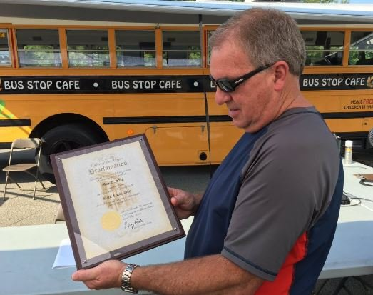 """Retiring JCPS transportation director Rick Caple with the proclamation declaring May 27 """"Rick Caple Day"""" in Louisville (Photo by Toni Konz, WDRB News)"""