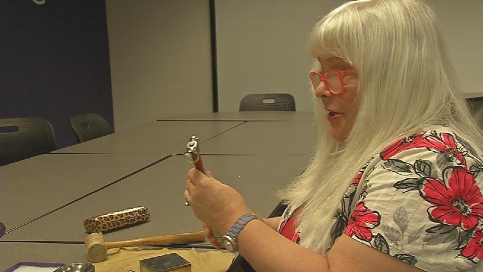 Jewelry designer Barbara Boles works on earrings