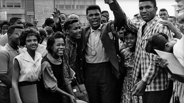 Ali celebrates his 1960 Gold Medial with classmates at Central High School. (AP photo)