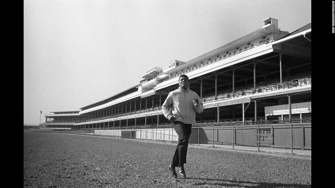 Then-Cassius Clay running on the track at Churchill Downs, 1963. (Photo via CNN by Curt Gunther, from Steve Gunther)