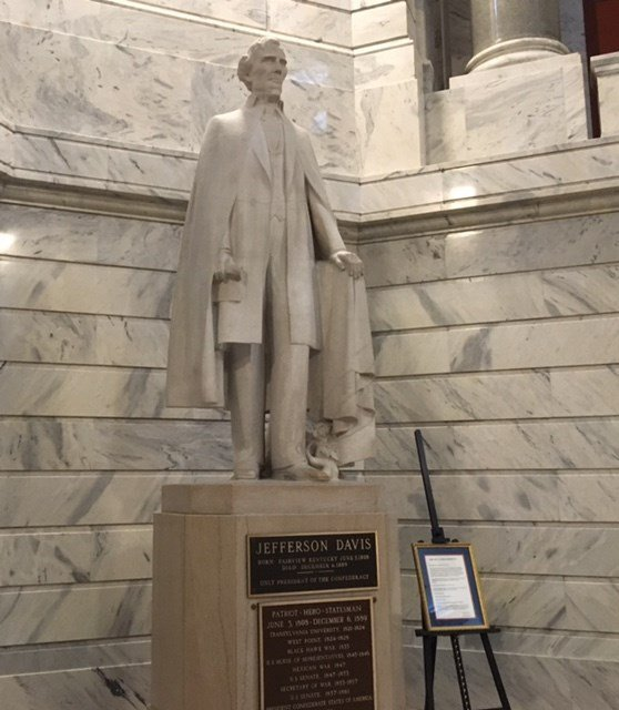 The 15-foot (4.5 meter) marble statue of Jefferson Davis sits just behind a 14-foot bronze statue of Abraham Lincoln. Both men were born in Kentucky.