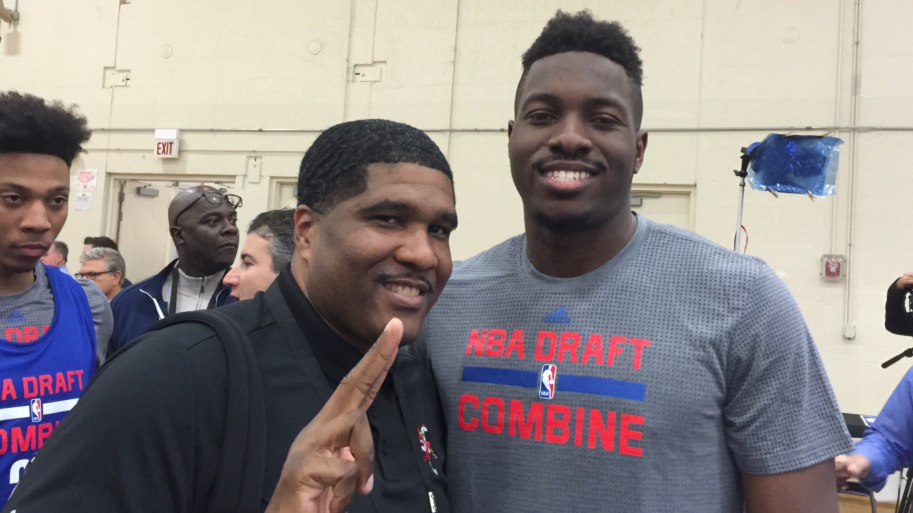 Chinanu Onuaku (right) appeared at the NBA Draft combine with U of L assistant coach Kenny Johnson.