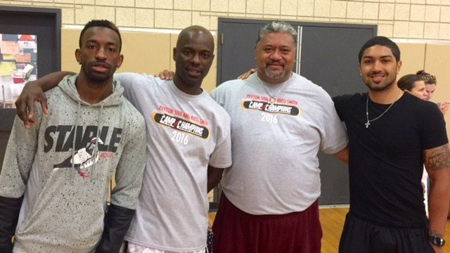 Russ Smith and his father, Russ Sr., and Peyton Siva Sr. and his son, Peyton (from run) turn their yearly basketball camp into a family affair.