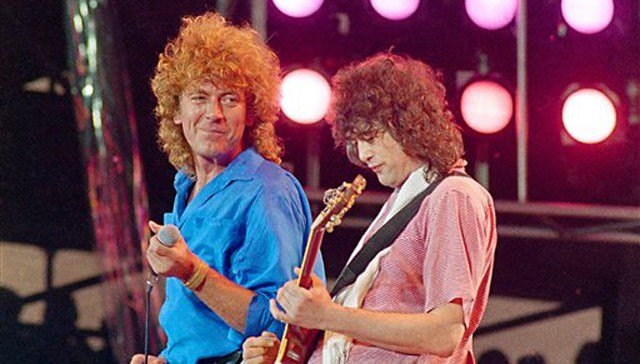 (AP Photo/Amy Sancetta, File). FILE - In this July 13, 1985 file photo, Led Zeppelin bandmates, singer Robert Plant, left, and guitarist Jimmy Page, reunite to perform for the Live Aid famine relief concert at JFK Stadium in Philadelphia.